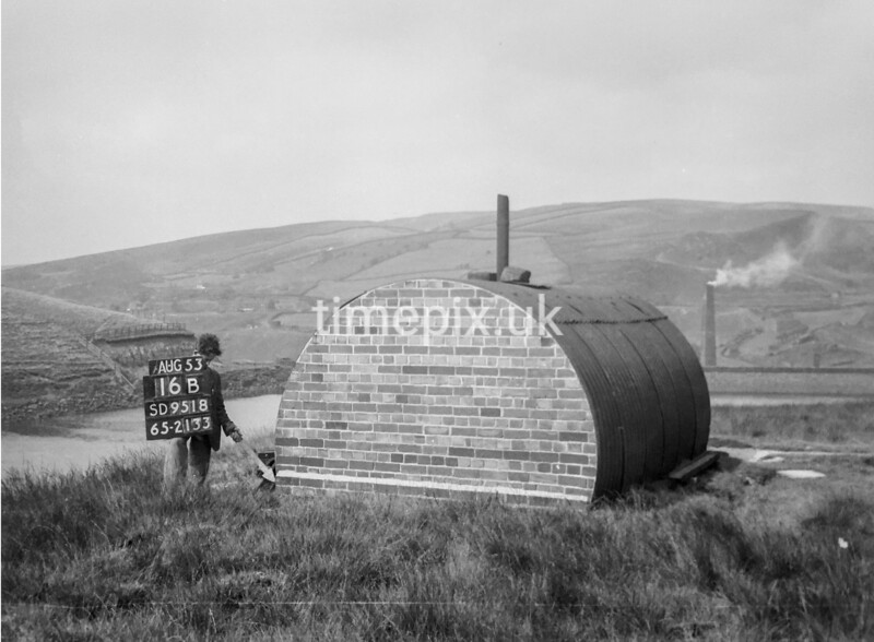 SD951816B, Man marking Ordnance Survey minor control revision point with an arrow in 1950s