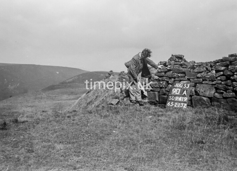 SD941990A, Man marking Ordnance Survey minor control revision point with an arrow in 1950s