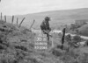 SD941530B, Man marking Ordnance Survey minor control revision point with an arrow in 1950s