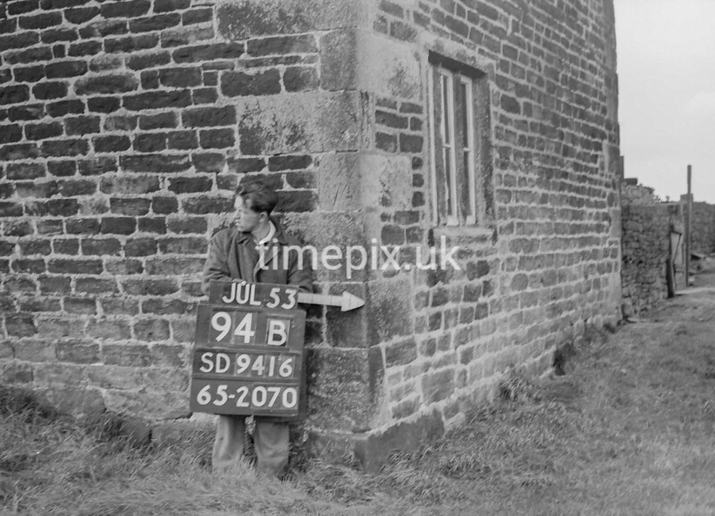 SD941694B, Man marking Ordnance Survey minor control revision point with an arrow in 1950s