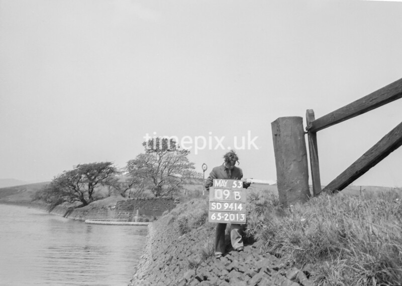 SD941409B, Man marking Ordnance Survey minor control revision point with an arrow in 1950s