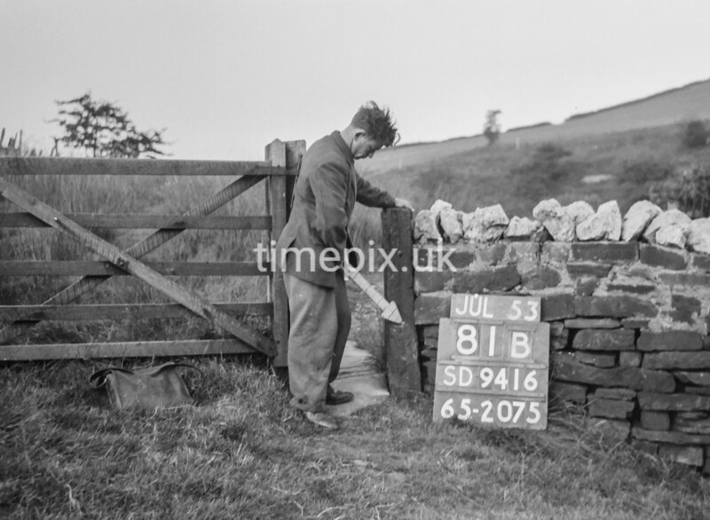 SD941681B, Man marking Ordnance Survey minor control revision point with an arrow in 1950s