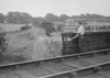 SD941741A, Man marking Ordnance Survey minor control revision point with an arrow in 1950s