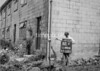 SD941882A, Man marking Ordnance Survey minor control revision point with an arrow in 1950s