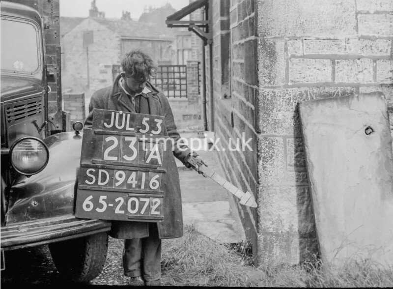 SD941623A, Man marking Ordnance Survey minor control revision point with an arrow in 1950s