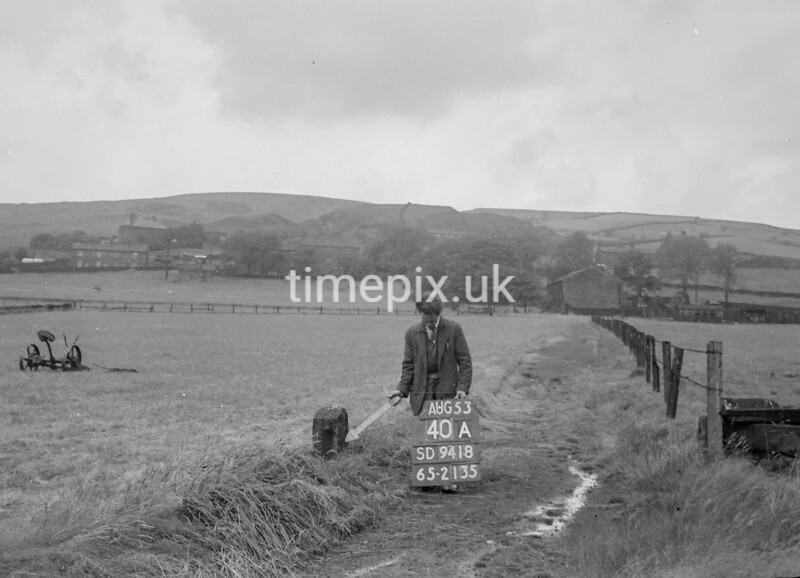 SD941840A, Man marking Ordnance Survey minor control revision point with an arrow in 1950s