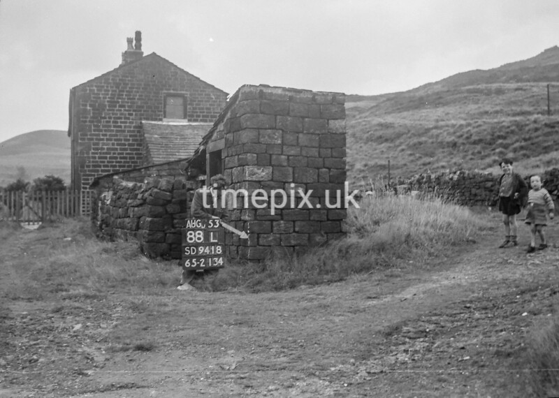 SD941888L, Man marking Ordnance Survey minor control revision point with an arrow in 1950s