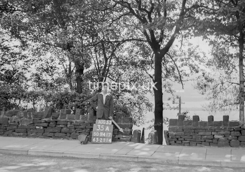 SD941735A, Man marking Ordnance Survey minor control revision point with an arrow in 1950s