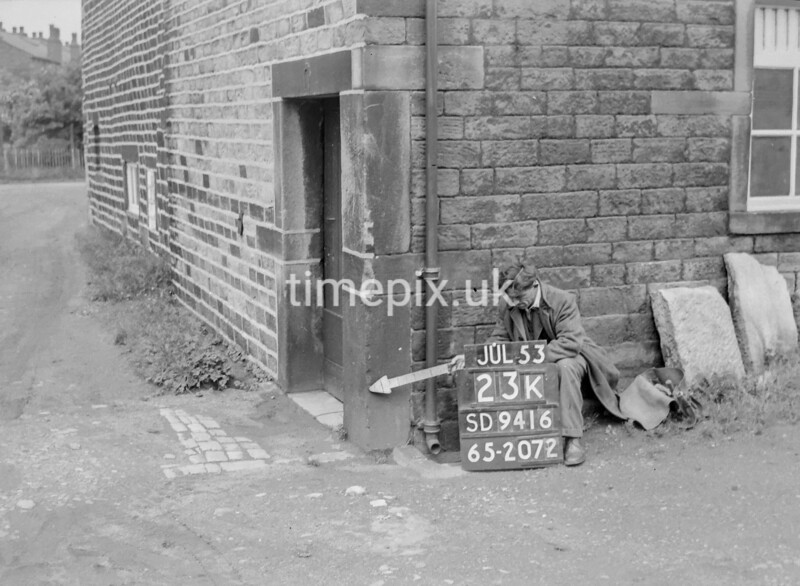 SD941623K, Man marking Ordnance Survey minor control revision point with an arrow in 1950s