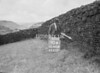SD941890A, Man marking Ordnance Survey minor control revision point with an arrow in 1950s