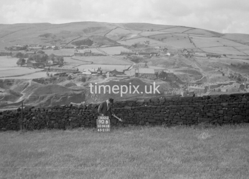 SD941890B, Man marking Ordnance Survey minor control revision point with an arrow in 1950s
