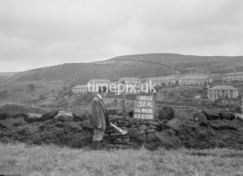 SD941851K, Man marking Ordnance Survey minor control revision point with an arrow in 1950s