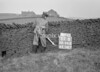 SD941261B, Man marking Ordnance Survey minor control revision point with an arrow in 1950s