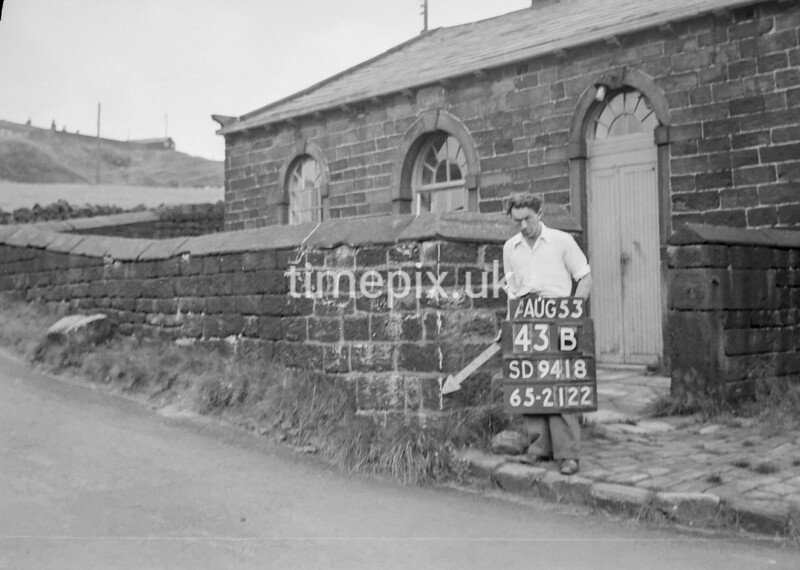 SD941843B, Man marking Ordnance Survey minor control revision point with an arrow in 1950s