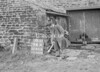 SD941694A, Man marking Ordnance Survey minor control revision point with an arrow in 1950s
