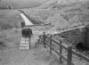 SD941888A, Man marking Ordnance Survey minor control revision point with an arrow in 1950s