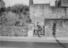 SD941759A, Man marking Ordnance Survey minor control revision point with an arrow in 1950s