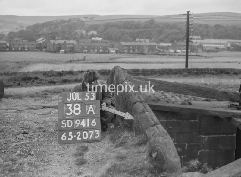 SD941638A, Man marking Ordnance Survey minor control revision point with an arrow in 1950s