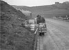 SD951200B, Man marking Ordnance Survey minor control revision point with an arrow in 1950s