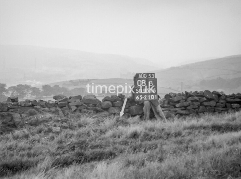 SD951608B, Man marking Ordnance Survey minor control revision point with an arrow in 1950s