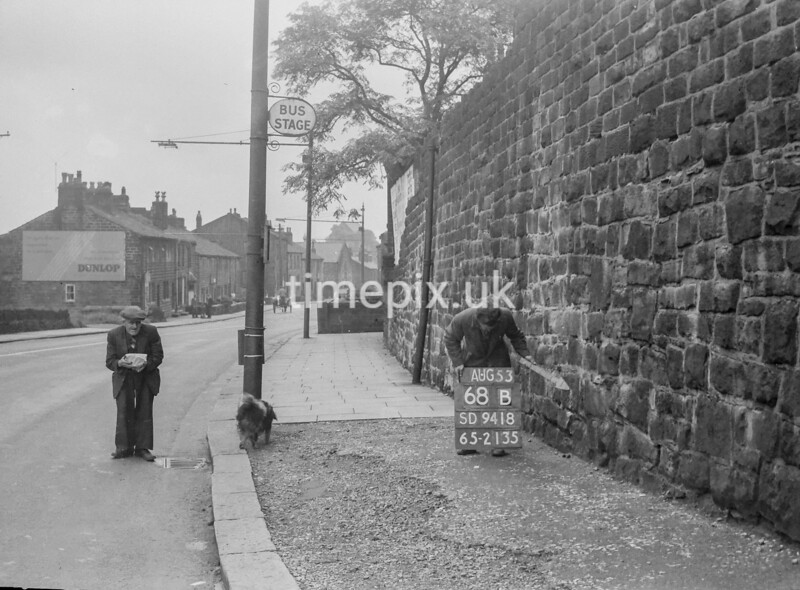 SD941868B, Man marking Ordnance Survey minor control revision point with an arrow in 1950s
