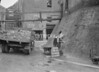 SD941878K, Man marking Ordnance Survey minor control revision point with an arrow in 1950s