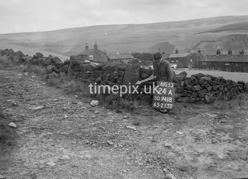 SD941824A, Man marking Ordnance Survey minor control revision point with an arrow in 1950s