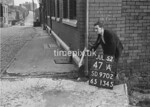 SD970247A, Man marking Ordnance Survey minor control revision point with an arrow in 1950s