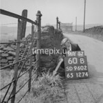 SD960260B, Man marking Ordnance Survey minor control revision point with an arrow in 1950s