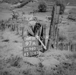 SD960197A, Man marking Ordnance Survey minor control revision point with an arrow in 1950s