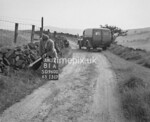 SD960081A, Man marking Ordnance Survey minor control revision point with an arrow in 1950s