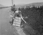 SD960176A, Man marking Ordnance Survey minor control revision point with an arrow in 1950s