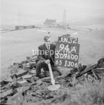 SD960094A, Man marking Ordnance Survey minor control revision point with an arrow in 1950s