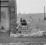 SD950093A, Man marking Ordnance Survey minor control revision point with an arrow in 1950s