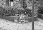 SD970198B, Man marking Ordnance Survey minor control revision point with an arrow in 1950s