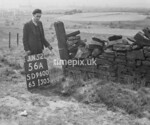 SD960056A2, Man marking Ordnance Survey minor control revision point with an arrow in 1950s
