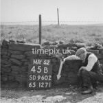 SD960245B, Man marking Ordnance Survey minor control revision point with an arrow in 1950s