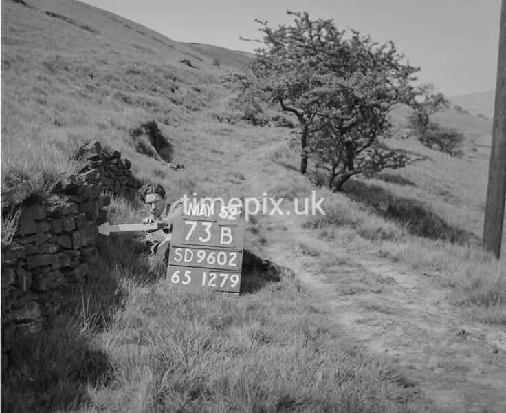 SD960273B, Man marking Ordnance Survey minor control revision point with an arrow in 1950s
