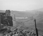 SD960083B, Man marking Ordnance Survey minor control revision point with an arrow in 1950s