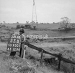 SD950133B, Man marking Ordnance Survey minor control revision point with an arrow in 1950s