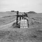 SD950133A, Man marking Ordnance Survey minor control revision point with an arrow in 1950s