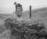SD960080B, Man marking Ordnance Survey minor control revision point with an arrow in 1950s