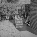 SD960290A, Man marking Ordnance Survey minor control revision point with an arrow in 1950s