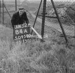 SD950084A, Man marking Ordnance Survey minor control revision point with an arrow in 1950s