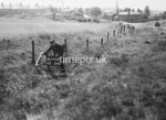 SD950019A, Man marking Ordnance Survey minor control revision point with an arrow in 1950s