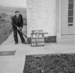 SD950067A, Man marking Ordnance Survey minor control revision point with an arrow in 1950s
