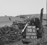 SD950298B, Man marking Ordnance Survey minor control revision point with an arrow in 1950s