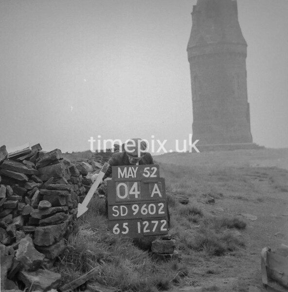 SD960204A, Man marking Ordnance Survey minor control revision point with an arrow in 1950s