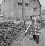 SD960016B, Man marking Ordnance Survey minor control revision point with an arrow in 1950s