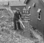 SD950093B, Man marking Ordnance Survey minor control revision point with an arrow in 1950s